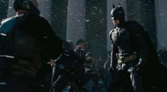 File:TDKR- Joe Fishel stuntman as Orange-lined policeman between Bane & Batman.jpg