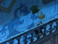 Goofy grabbing Scrooge's hat