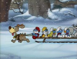 Smurfs riding a sled