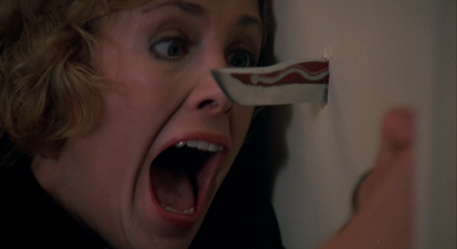 File:Childs-Play-1988-Catherine-Hicks-knife-through-door.png