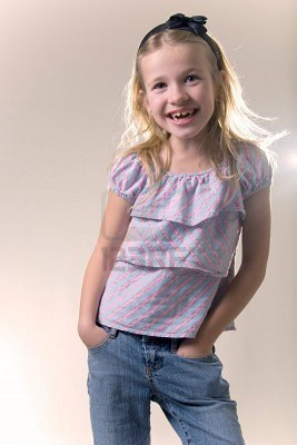 File:702966-cute-blonde-little-eight-year-old-girl-in-purple-shirt-smiling-with-hands-in-pockets-of-jeans.jpg