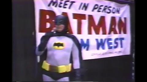 Adam West as BATMAN (in costume) signing autographs 1989
