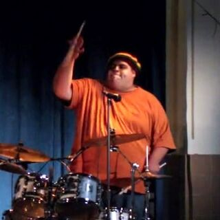 <center><b>Drummer</b></center>Unnamed drummer who provided percussion for the band. The drummer would also later provide back up for Vaughn when he sang a song to <a href=