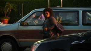 Shirley exits the minivan