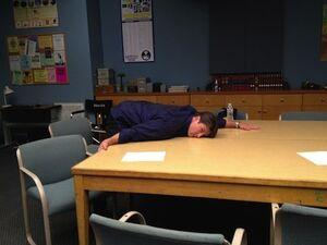 Nathan hugs study table