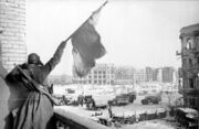 Soviet soldier-Red Banner-central plaza of Stalingrad-1943
