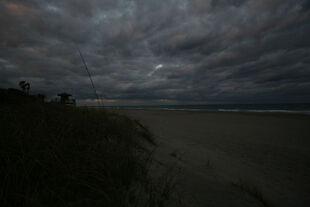 Dark-looming-clouds-over-juno-beach-floirda-hdr-pier-beach-lifeguard-tower-4