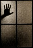 5645061-slightly-blurred-silhouette-of-a-hand-behind-a-window-or-glass-door-symbolizing-horror-or-fear
