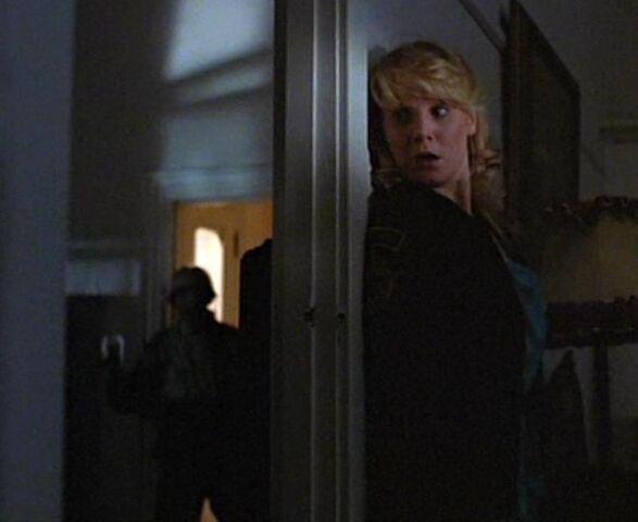 File:The-prowler-hiding-behind-door.jpg