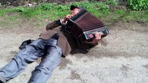 File:Drunk accordian player.jpg