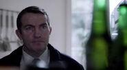 Ronnie's eyes on the bottles in Matt's fridge in Survivor's Guilt