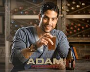 Adam Rodriguez (drinking beer)