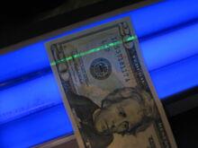 US $20 under blacklight