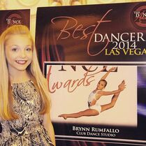 Brynn with poster of previous year award - TDA - 2015-07-06