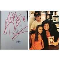 Abby Lee scratching out Haleys signature in book signing