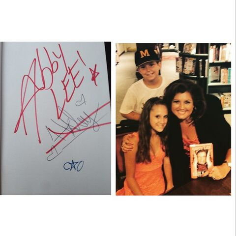 File:Abby Lee scratching out Haleys signature in book signing.jpg