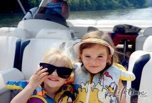 Young Paige and Brooke on boat