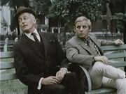 Dark Shadows alumni Hugh Franklin and James Hall meeting on a park bench for a transaction