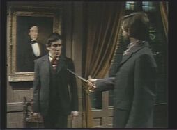Quentin threatens Barnabas with a sword