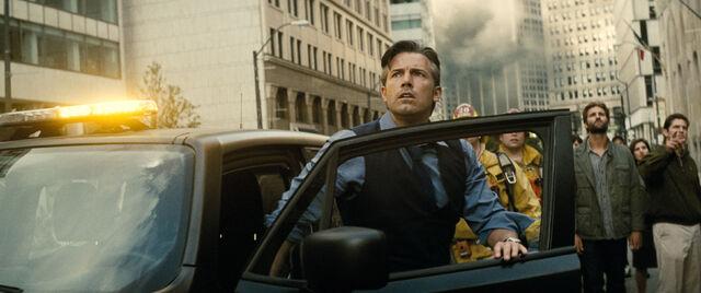File:Bruce Wayne looks up at the destruction.jpg
