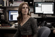 Lois Lane at her Daily Planet desk
