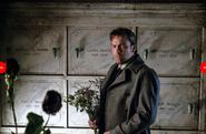 Bruce stands in the Wayne mausoleum