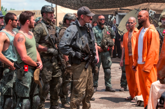 File:Soldiers face Task Force X in prison uniform.png