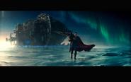 Superman pulls along a capsized ship