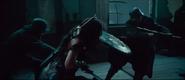 Wonder Woman fighting off Allied troops