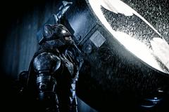 Batman looks up from the Batsignal
