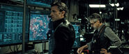 Bruce Wayne and Alfred Pennyworth at the computers