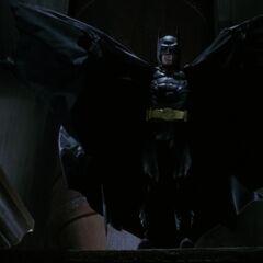 Batman stops a mugging.