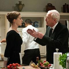 Selina with Alfred at Wayne Manor.