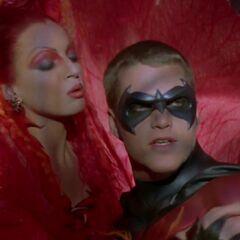Poison Ivy seduces Robin.
