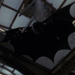 Batman crashes in to save Vicki.