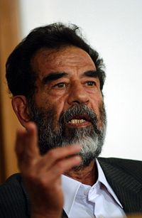 200px-Saddam Hussein at trial, July 2004
