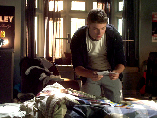 File:Riley In His Room With A Pile of Clothes Reading A Note.jpg