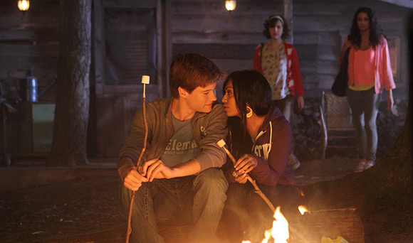 File:Jake & Alli Sitting By The Fire Roasting Marshmallows With Their Faces Close To Each Other With Bianca & Clare Watching From Behind.jpg