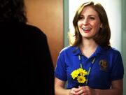 329px-Holly J In Her Degrassi Uniform Looking At Fiona With Three Yellow Flowers In Her Hand