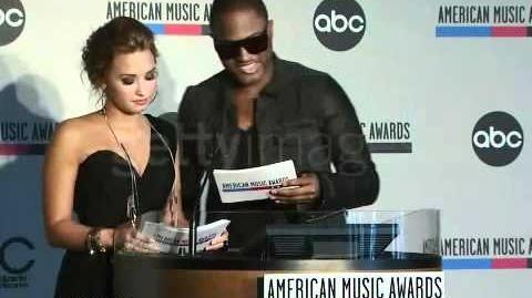 Demi Lovato and Taio Cruz announce the 2010 AMA Nominees