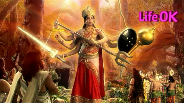 File:Eight-Armed Goddess Adishakti Grows To Massive Size in Front of Tridev.png