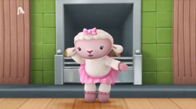 File:Lambie by the fireplace.jpg