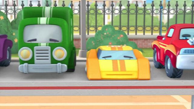 File:Green truck yellow racecar.jpg