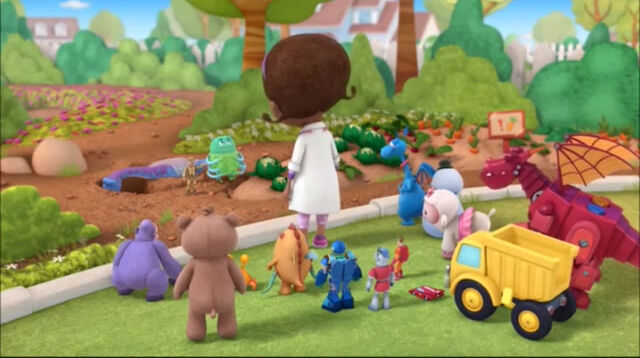 File:Doc and toys at the garden.jpg