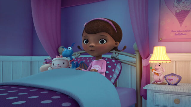 File:Doc and toys in bed.jpg