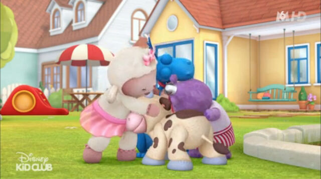 File:Lambie, stuffy, hallie and moo moo hugging.jpg