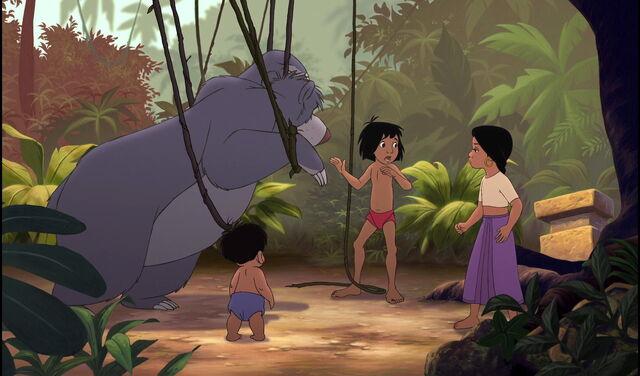 File:Mowgli is telling Shanti and Ranjan not to be scared of Baloo the bear.jpg
