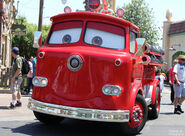 Red the firetruck cruising through Cars Land