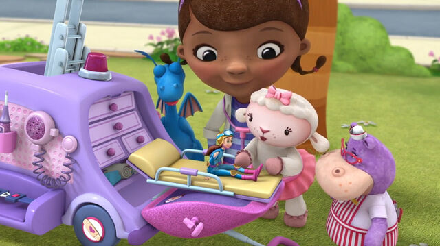 File:Doc and toys with dress up daisy.jpg