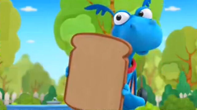 File:Stuffy holds up bread.jpg